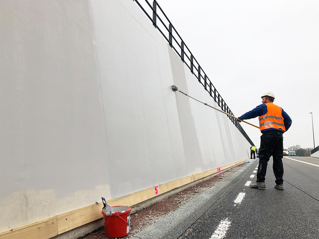 Betoncoating aanbrengen tunnel roller Proned